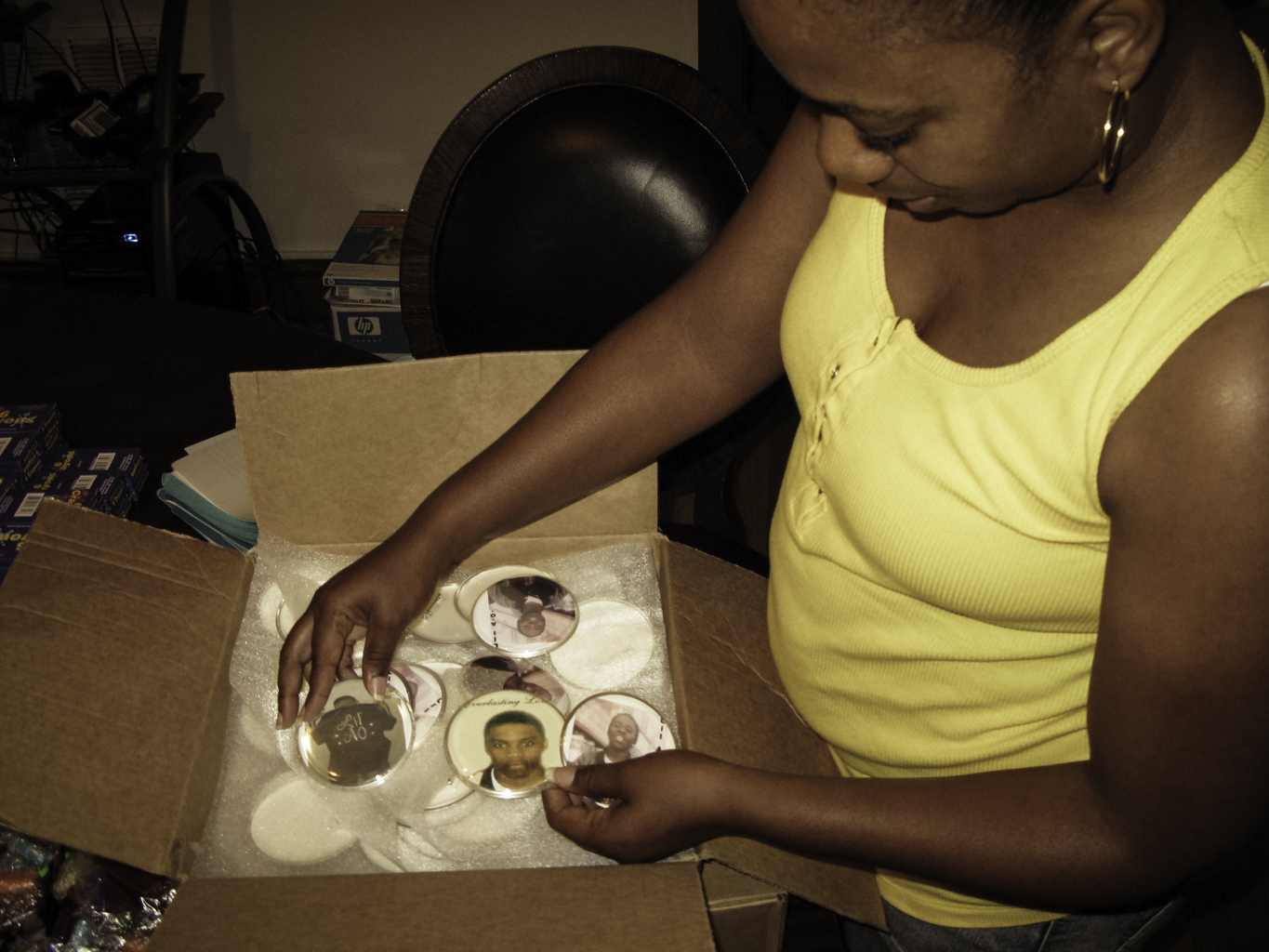 Annie holds Lil' A.O. memorial buttons she has made. They will also be distributed at the Back to School Barbecue.