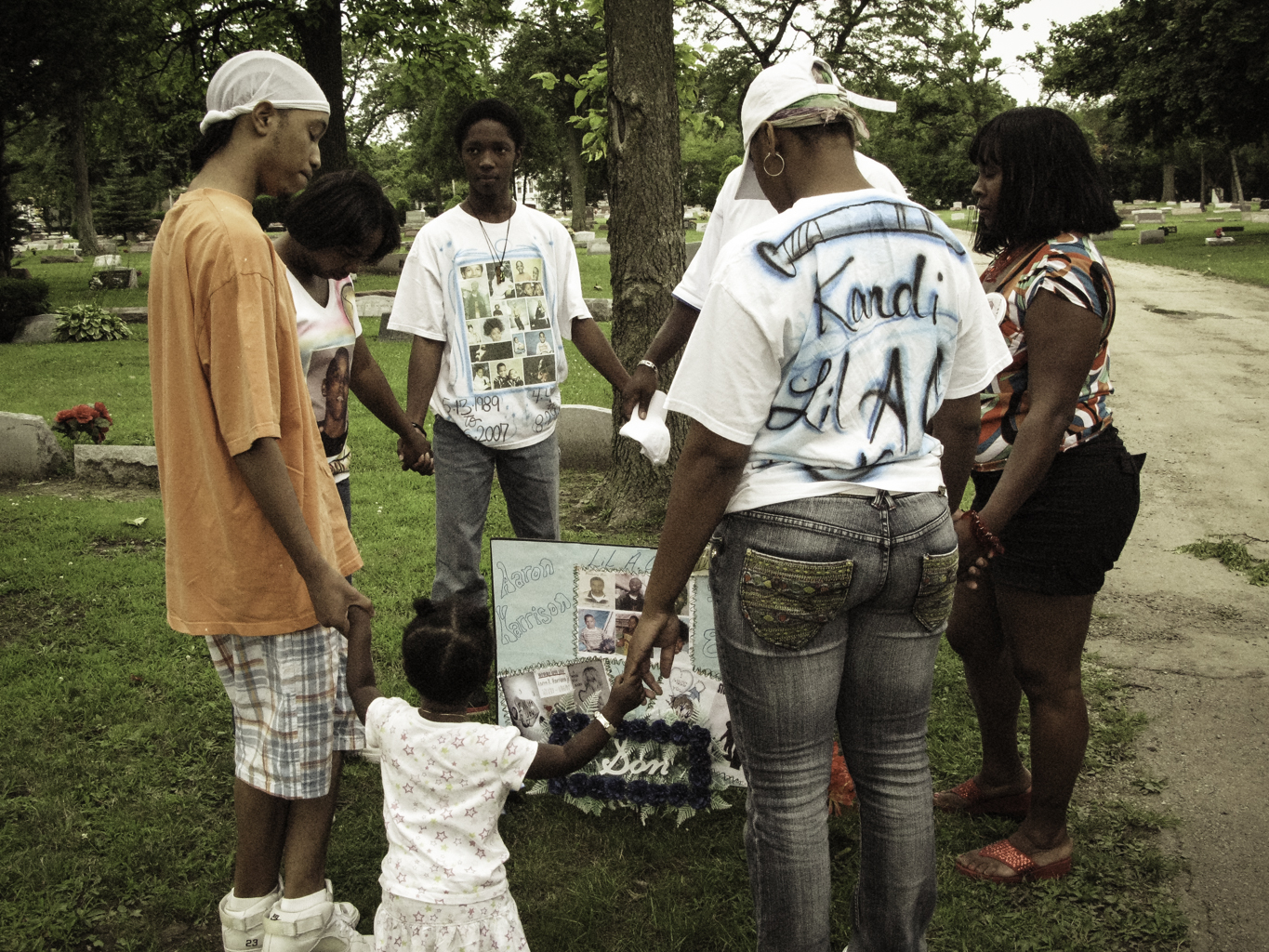 Annie and family pray at Lil' A.O.'s grave. They ask for answers and beg for justice.