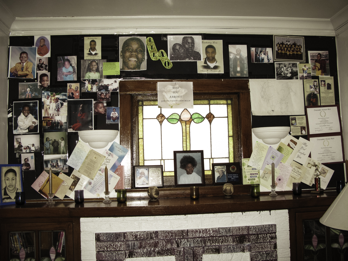 A memorial for Lil' A.O. that Annie Johnson has built above the mantel in her home.